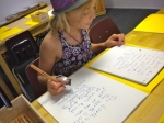 Recopying edited dictation into her main lesson book